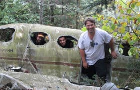 men find old airplane crash