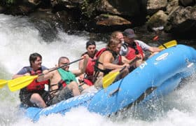 men white water rafting