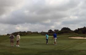 men golfing for benefit