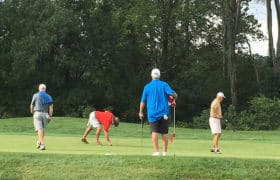 men golfing for benefit