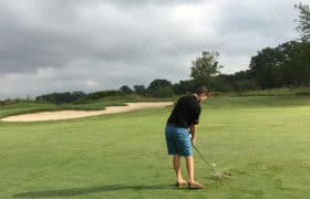 man golfing for benefit