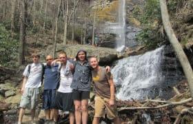 men on waterfall