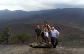 men posing on mountain